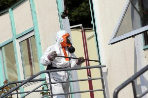 Asbestos being removed from a property